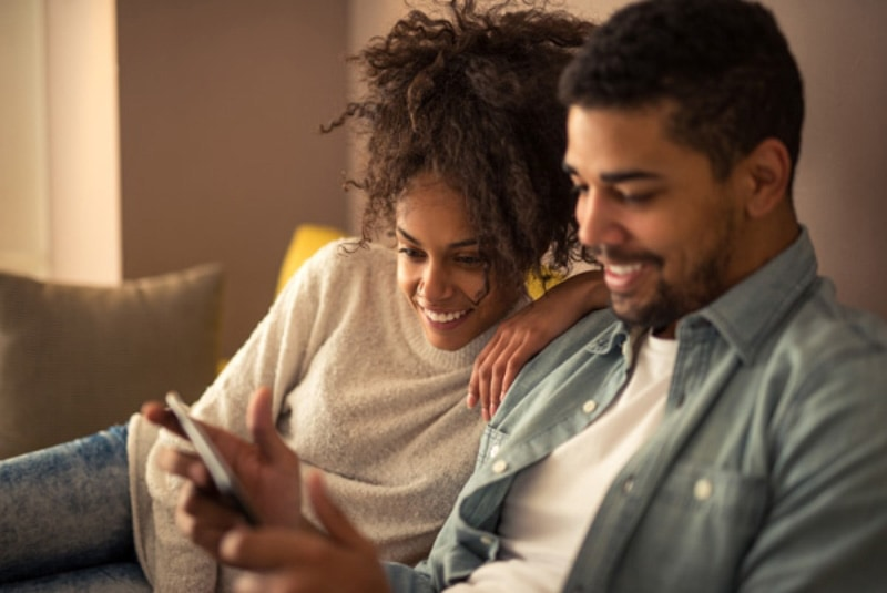 Couple Smiling at a smartphone