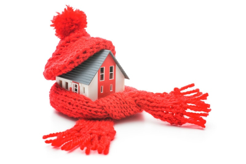 Toy house wearing a red hat and scarf.