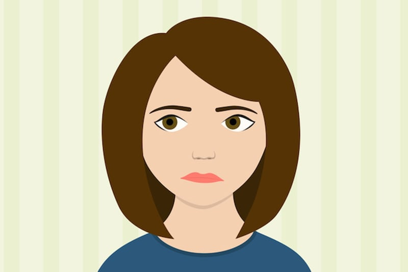 girl with brown hair looking sad